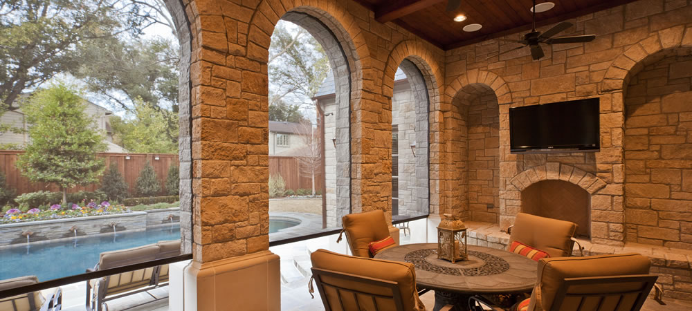 Beautiful Dallas, TX rock porch with motorized porch shades